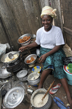 Small-scale commercial food vendors in Cote d'Ivoire use improved cookstoves to meet the demand of their patrons.