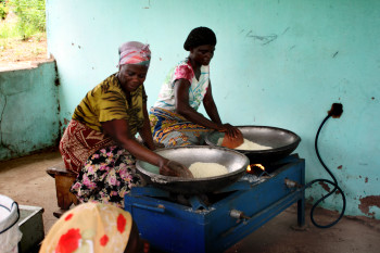 Ghanaian cooks use commercial stoves fueled by gas to scale-up their business.