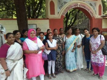 Komal, Rubina and Sapna stand with other members of the Dakshata Committee in Shivajinagar