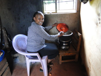 "Woman demonstrates how she cooks with a BURN ""Jikokoa"" (saving stove) in rural Kenya. Jikokoas burn more efficiently, reducing spending on charcoal and time required for cooking, and producing less smoke."